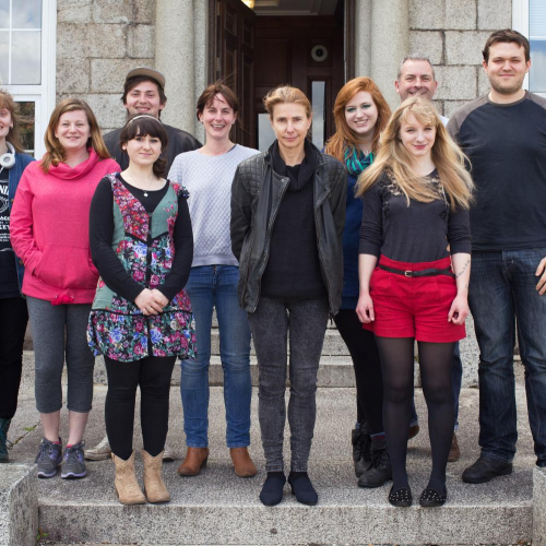 Group of Creative Writing students standing for portrait to welcome writer in residence, Lionel Shriver.