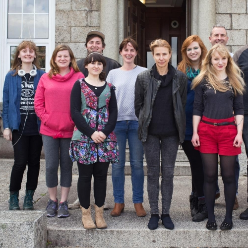 Group of students standing for portrait to welcome writer in residence, Lionel Shriver.