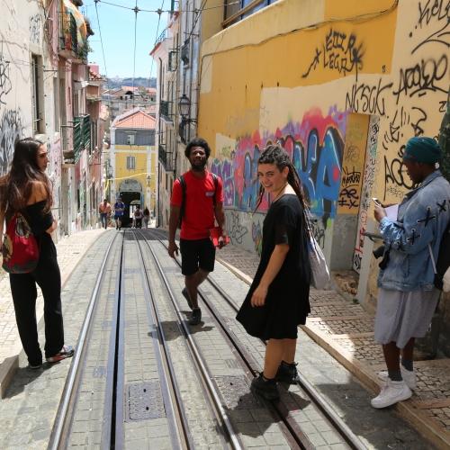 Group of people walking in street in Guinea Bassau
