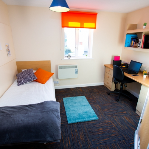 Single bedroom with desk at Tuke House halls of residence