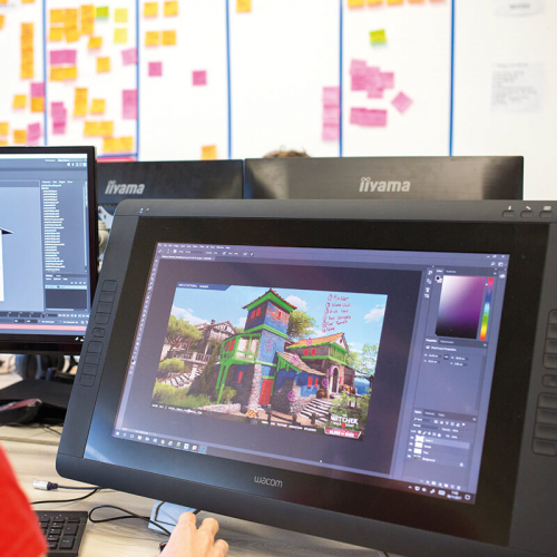 Games student working on digital game artwork on a screen.