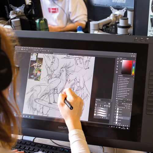 Game Art student drawing birds on a digital screen