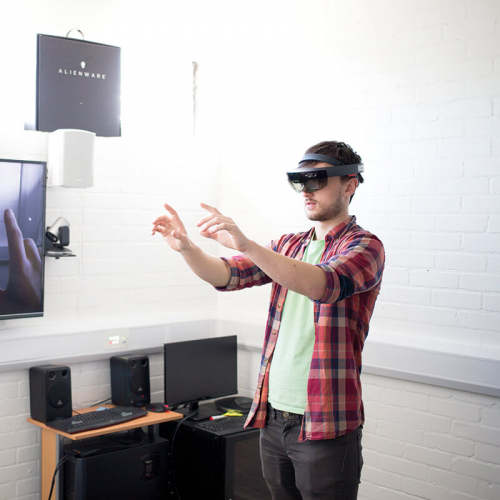 Games Academy student wearing a virtual reality headset with a TV screen