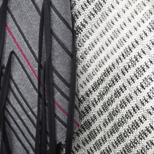 Black, grey and pink hand woven fabric samples.