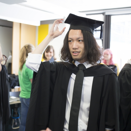 Graduand receiving gown and hat for Falmouth University graduation 2019