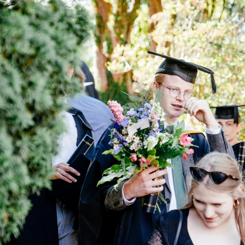 Graduate holding bouquet of flowers at graduation 2019