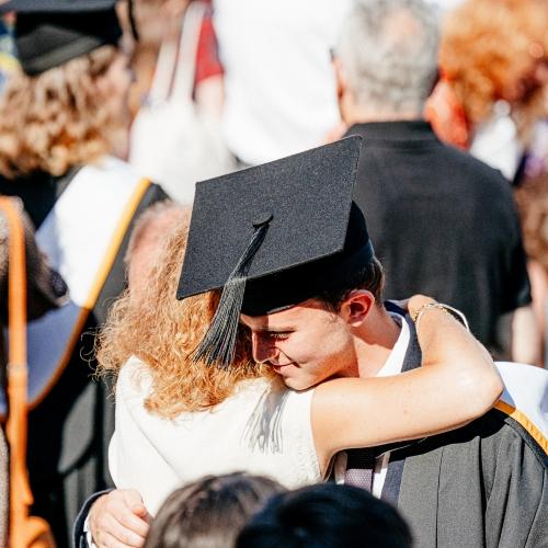 Falmouth University graduate embracing family at graduation 2019