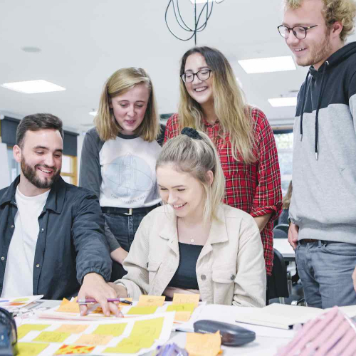 Graphic Design group of students around table