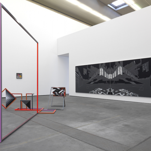 Photograph of a gallery space with a large grey canvas and a purple frame