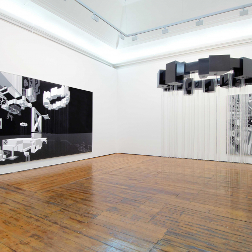 Gallery interior with large canvases on the wall and a metal installation
