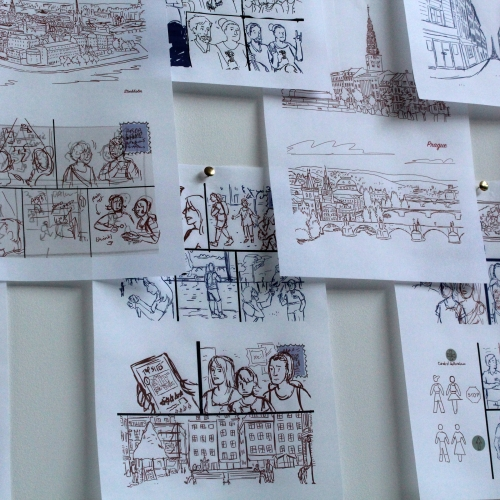 Storyboard style illustrations pinned up onto a board.