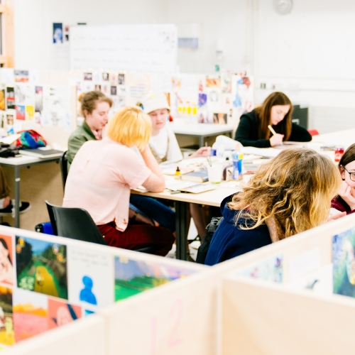 Students working in an illustration studio