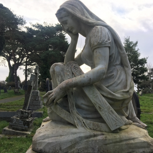Headstone of a woman in a graveyard