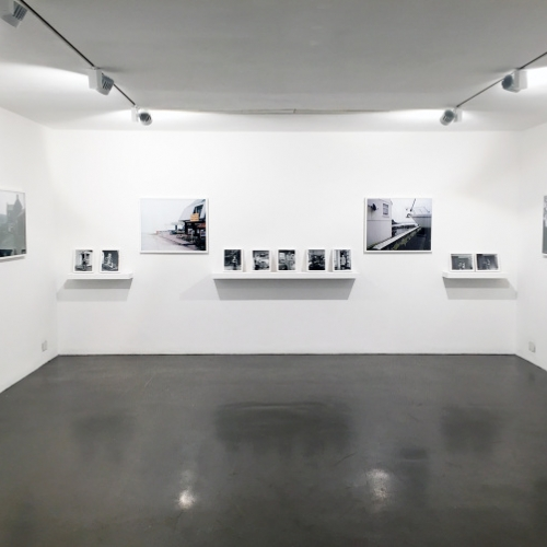 Gallery with photos on the wall