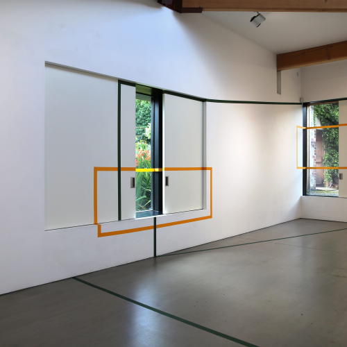 Gallery space with windows and an orange outline