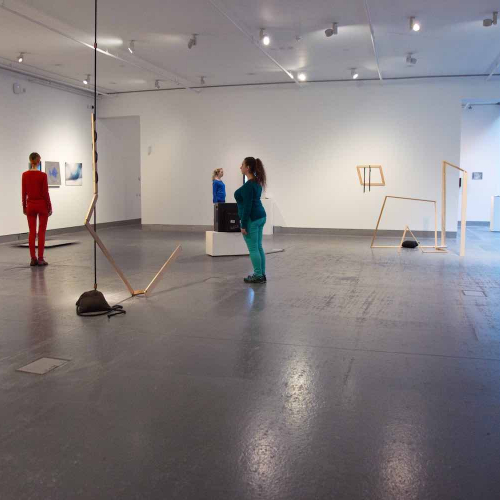 Gallery space with women stood still