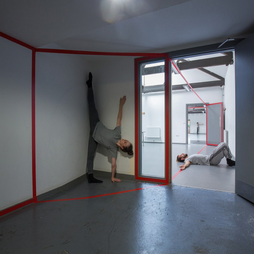 Interior rooms with dancers performing in the space