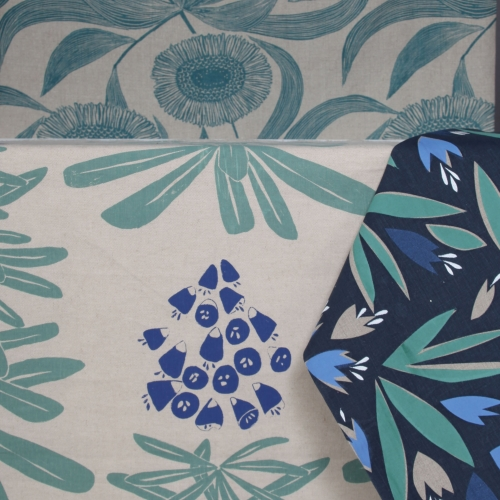 Hand printed floral fabric in green and blue.