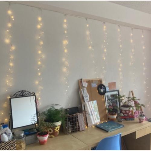 fair lights hanging above a desk in student bedroom
