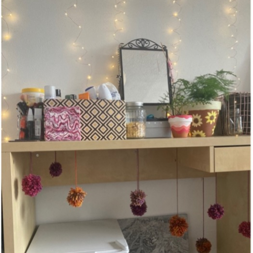 Decorated desk space in student bedroom