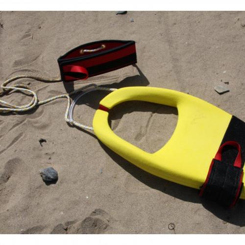 Yellow life float design on sandy beach