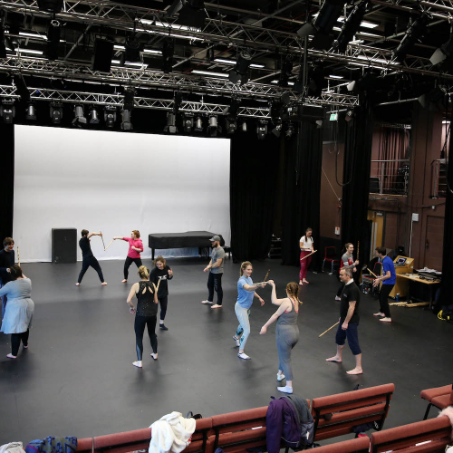 Students in a stage fighting workshop in AMATA studio