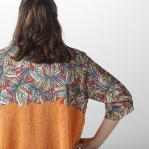 Model wearing jacket with digitally printed flower pattern.