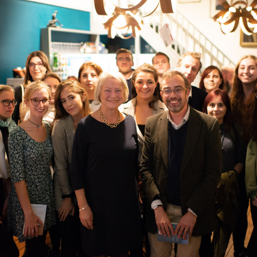 Kate Adie having photograph taken with a group of Falmouth University Journalism students.