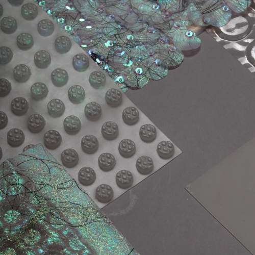 Iridescent fabric circles and sequins.
