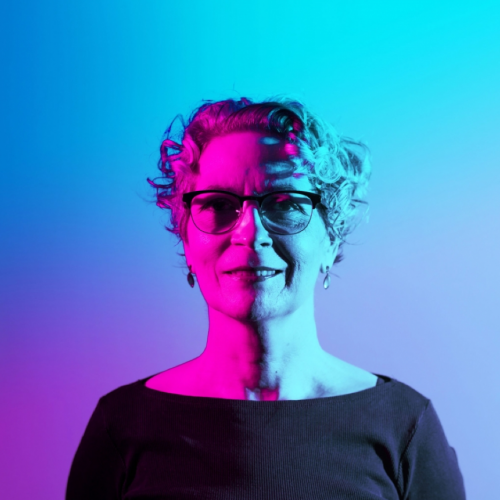 Portrait of Kitty Taylor in blue and purple light