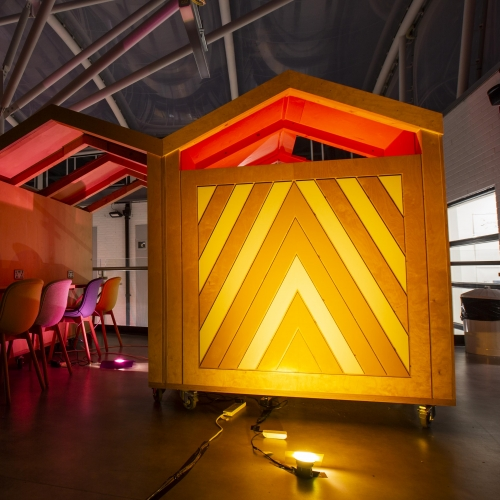 Wooden work spaces illuminated in yellow light