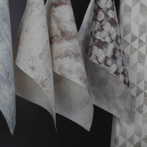 Samples of digitally printed fabric in whites and greys.