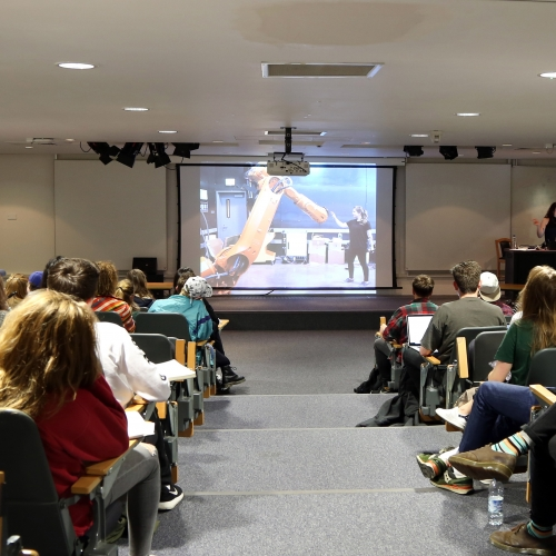 Students watching presentation in lecture theatre on Falmouth campus