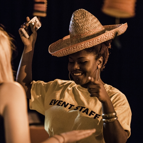 Student dancing with sombrero on at Mexican Fiesta event