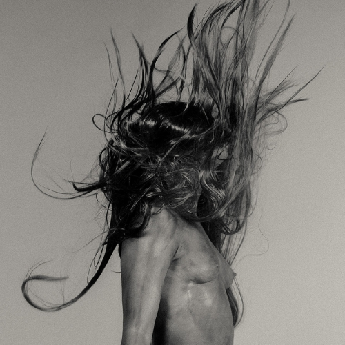 topless figure with wild hair