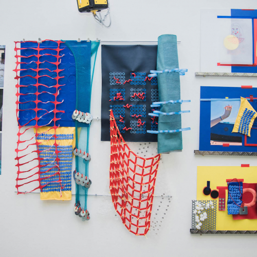Display of textile designs with netting and shapes