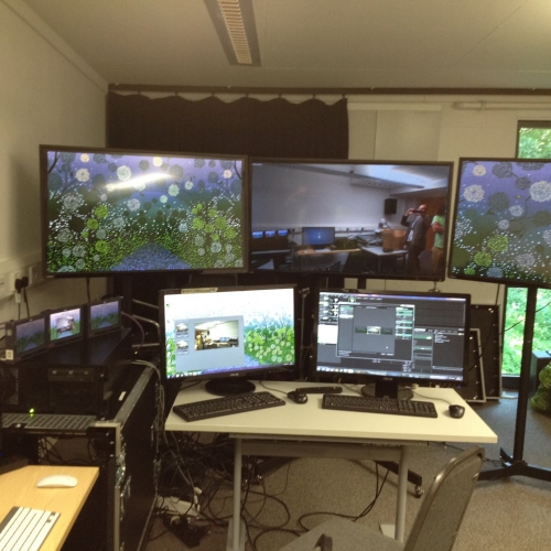 Five computer monitors in a room