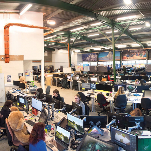 View of busy games academy, students working on computers