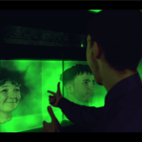 A man looking at heads in green boxes