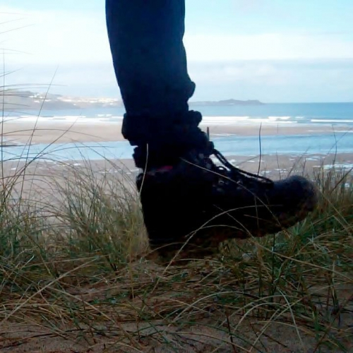 Photo of two feet on the sand