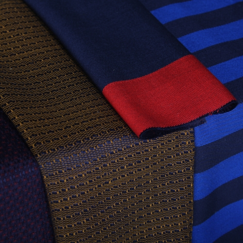 Hand woven fabric samples in dark colours.