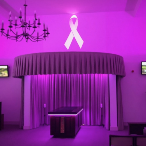 a purple room with a large curtain