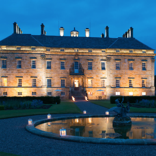Manor house floodlit by night