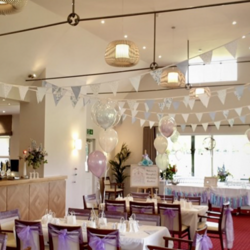 A room decorated with bunting and baloons