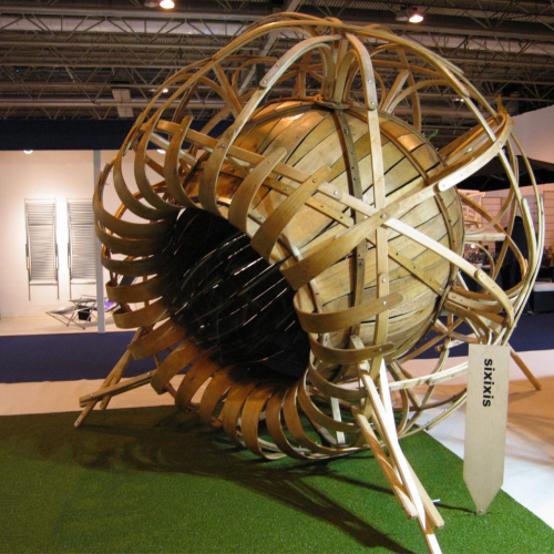 Large wooden sculpture that looks like a sunflower
