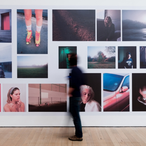 A person in a photography gallery