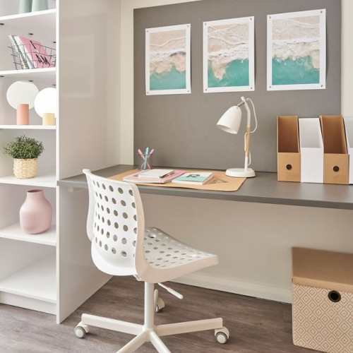 Desk space with chair and shelving units