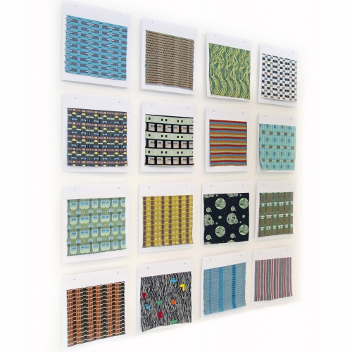 Wall display of different patterned and coloured samples.