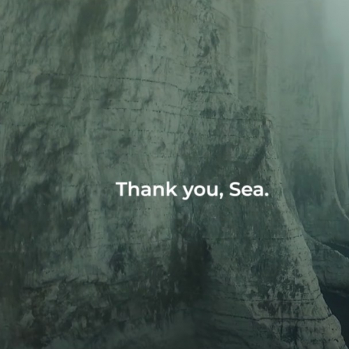 Cliff and ocean with Thank You Sea overlayed as text