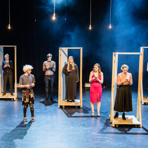 A stage performance featuring Acting students in door frames